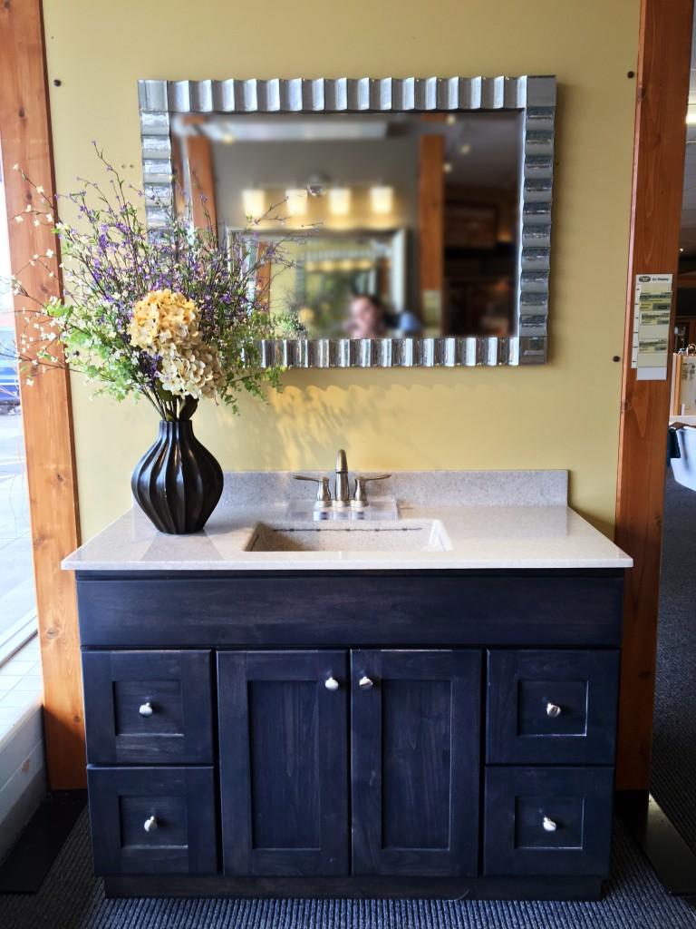Large dark brown vanity with flowers and mirror