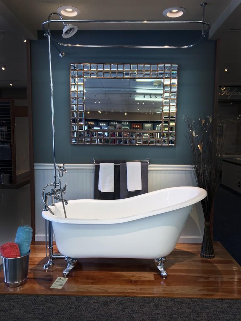 Vintage clawfoot bathtub with large mirror