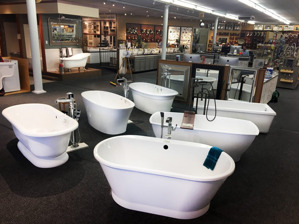 Showroom seven soaker bathtubs in entryway