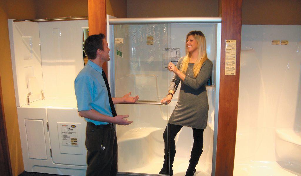 Customer standing in sterling shower with shower door